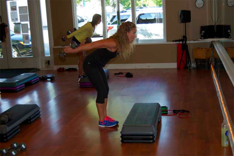 A step is employed to enhance leg exercises